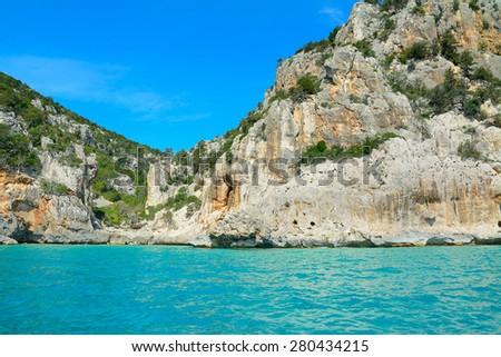 rocks and vegetation by the sea in Orosei Gulf, Sardinia - stock photo
