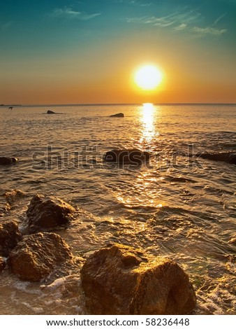 Rocks at Black Sea coast at sunrise - stock photo