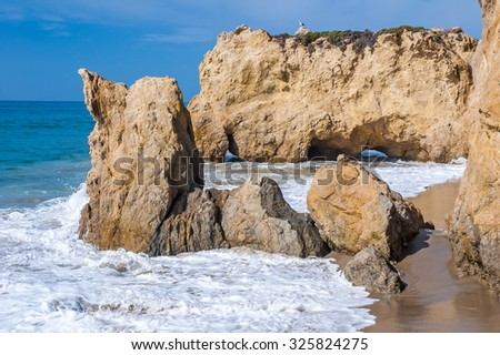 Rocks at the beach in Malibu, California, USA. - stock photo