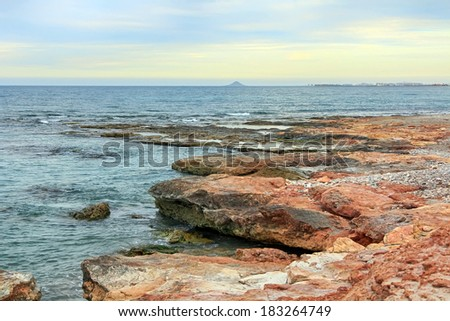 rocks at the edge of a calm sea
