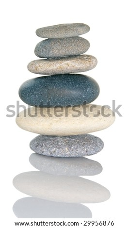 Rocks balanced on each other to symbolize balance in life and business. - stock photo