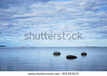 Rocks by the coast in a calm bay at the swedish island Oland in the Baltic Sea