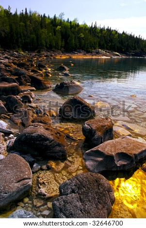 Rocks in clear golden water of Georgian Bay at Bruce peninsula Ontario Canada