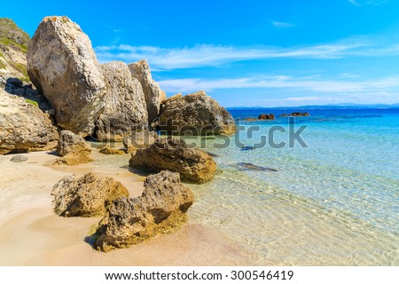 Rocks in crystal clear sea water on beautiful Grande Sperone beach, Corsica island, France