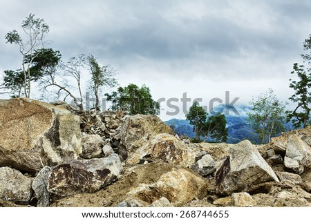 rocks in jungle under stormy sky, Thailand - stock photo