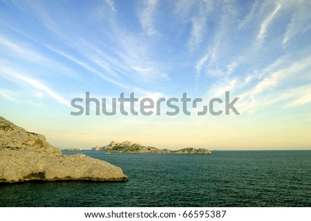 Rocks in the Mediterranean Sea near Marseille in the dusk - stock photo