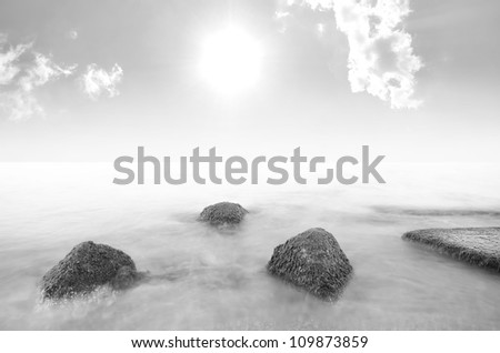 Rocks in the sea. Dramatic scene. Composition of nature