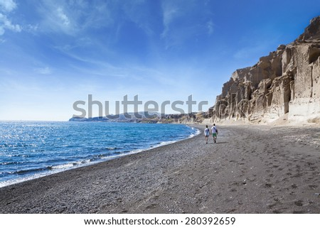 Rocks in the shape of the moon's surface. Fantastic Landscape. Santorini, Greece.Vlichada beach. Two come to rest on the seaside - stock photo