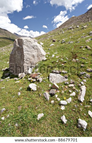 Rocks in valley,Caucasus mountains.Blue sky,clouds. Elbrus area.