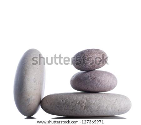 Rocks isolated on white inside studio. - stock photo