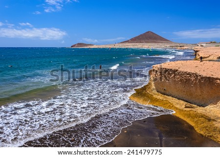 Rocks on El Medano volcanic beach, Tenerife island, Spain - stock photo