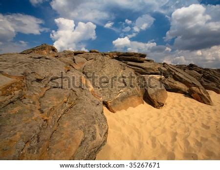 Rocks on sand - stock photo
