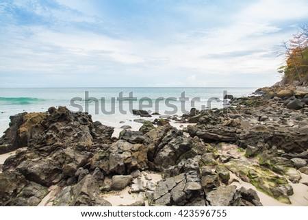 rocks on the beach and blue sky with beautiful clouds tropical sea,kata,karon,phuket,thailand - stock photo