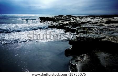 Rocks on the coastline at Sea Lion Island - stock photo