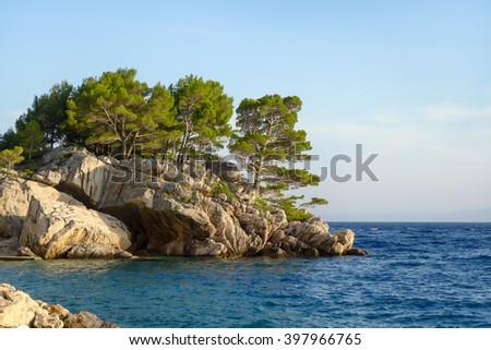 Rocks on the promenade of Brela at Makarska Riviera, adriatic Sea, Dalmatia, Croatia - stock photo