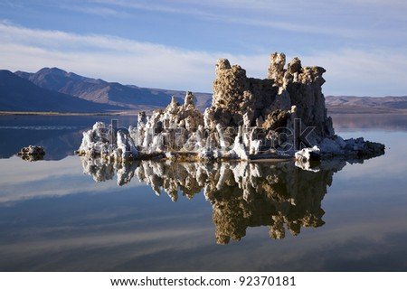 Rocks reflecting on the surface of Mono Lake, California. - stock photo