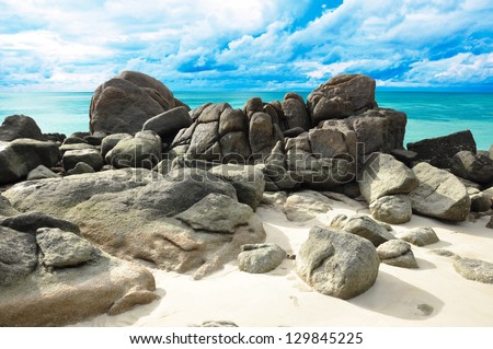 Rocks , sea and blue sky - Lipe island Thailand - stock photo