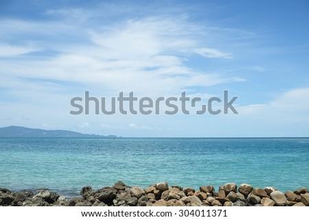 Rocks ,sea and blue sky- Phangan island,Thailand - stock photo