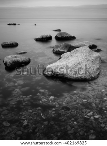 Rocks standing out of the water. Black and white photography