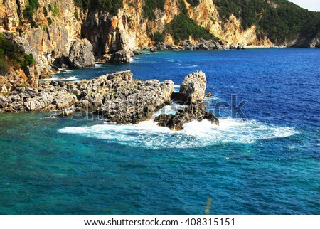 rocks surrounded by clear blue Ionian sea in Greece - stock photo