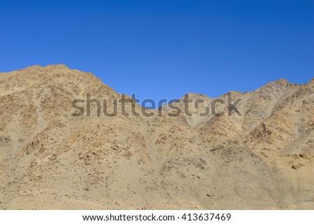 Rocks under a blue sky - stock photo