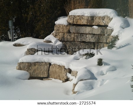 rocks wall in winter park - stock photo