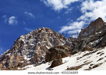 Rocks with snow at nice spring day. Turkey, Central Taurus Mountains, Aladaglar (Anti-Taurus). - stock photo