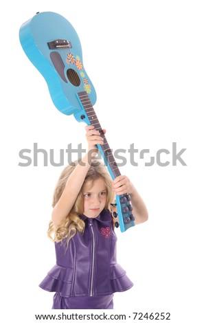 rockstar child smashing her guitar - stock photo