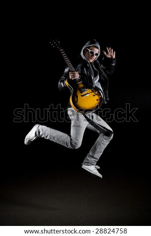 rockstar in the air - stock photo