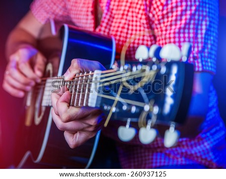 rockstar playing solo on guitar - stock photo