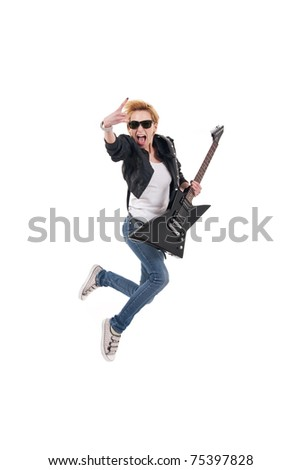 rockstar screaming and jumping with electric guitar making rock sign over white - stock photo