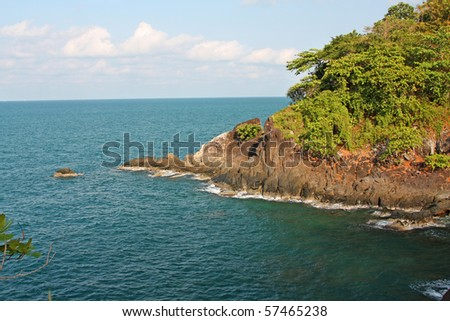 Rocky and wooded shore. Coast of Koh Chang island, Thailand