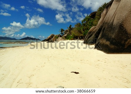 Rocky beach and footsteps - stock photo