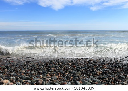 Rocky beach and surf - stock photo
