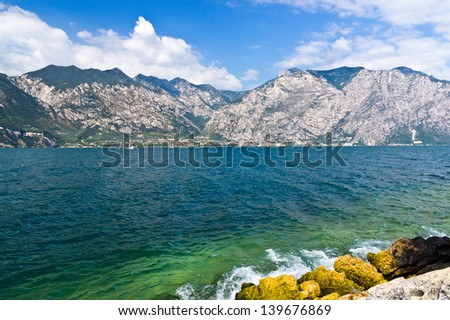 Rocky beach at Garda lake - stock photo