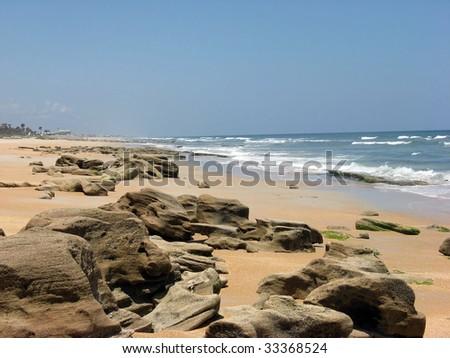 rocky beach in st.augustine,florida - stock photo