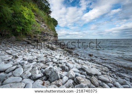 Rocky beach near Picton Ontario on Lake Ontario. - stock photo