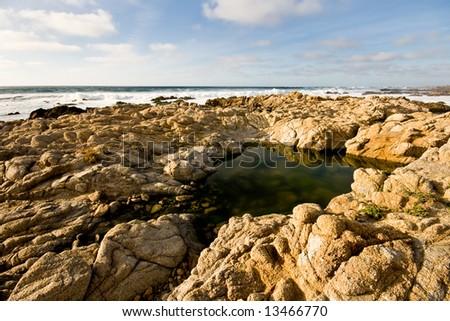 Rocky Beach Scene on Spring Day - stock photo