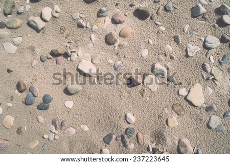 rocky beach with sand and pebbles - retro, vintage style look