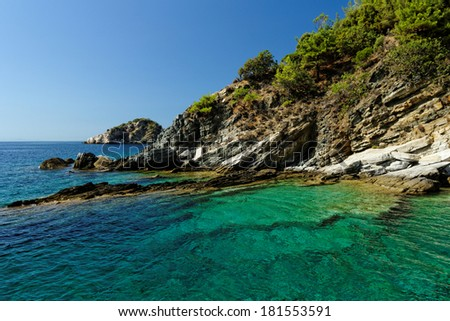 rocky beach with turquoise sea in greece thassos island - stock photo