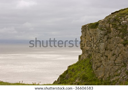 Rocky cliff by a stormy sea
