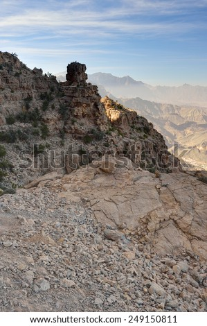 Rocky cliff with blue sky, Jabal Nakhal, Sultanate of Oman - stock photo