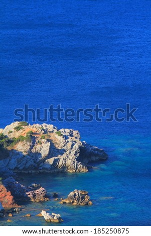 Rocky cliffs near coastal line of Adriatic sea - stock photo