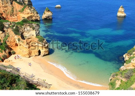 Rocky cliffs on the coast of the Atlantic ocean in Lagos, Algarve, Portugal - stock photo