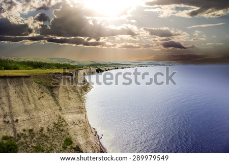 rocky cliffs on the sea shore - stock photo
