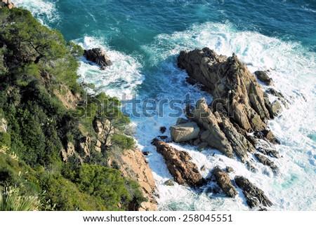 rocky coast and the sea - stock photo