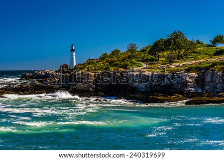 Rocky coast and view of Portland Head Light, at Fort Williams Park, Cape Elizabeth, Maine. - stock photo