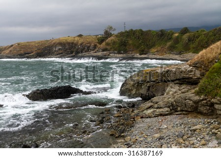 Rocky coast and waters of beach in Bulgaria - stock photo