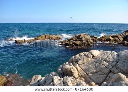 Rocky coast of a sea bay in Spain. - stock photo
