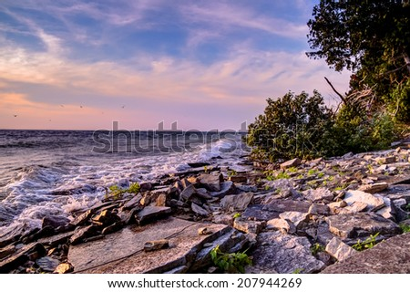 Rocky coast of a windy Lake Michigan.  Fayette State Park.  Garden, Michigan.   - stock photo